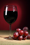 Still-life with glass of red wine Stock Images