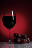 Still-life with glass of red wine Stock Image