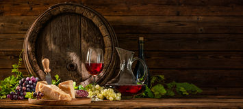 Still life with glass of red wine. And old oak wine barrel Royalty Free Stock Photography