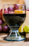 Still life - glass of red wine, yellow and red muscat grape, cheese on a canvas Royalty Free Stock Images