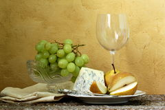 Still life glass of wine, blue cheese Royalty Free Stock Photography