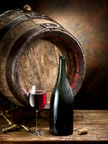 Still-life with glass of wine, bottle and barrel. Stock Photo