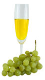 Still-life with a glass of wine and green grapes Stock Image