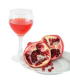 Still-life with a glass of wine and pomegranate Stock Images