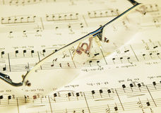 Still-life with glasses and folksong stave Royalty Free Stock Image