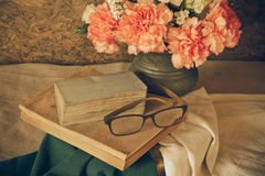 Still life with glasses resting on a book Royalty Free Stock Image