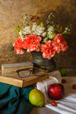 Still life with glasses resting on a book Royalty Free Stock Photo