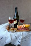 Still life with glasses of wine and a bottle of wine Stock Photography
