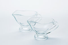 Still life with glassware. Glassware - two sauce boats on white background Royalty Free Stock Photos