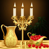 Still life with gold(en) dishes candle and wine Royalty Free Stock Photo