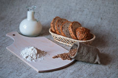 Still life with grains of wheat, bread, flour and milk. Royalty Free Stock Photo