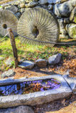 Still Life Granite Millstone and Granite Water Trough Stock Photography