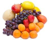 Still life of grape, lemons, pears, strawberry Stock Image