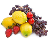 Still life of grape, lemons, pears, strawberry.Still-life on a white background Stock Photos