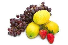 Still life of grape, lemons,  strawberry Royalty Free Stock Photos