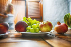 Still life of grape, peach, nectarine and pomegranate. Extremely. Shallow depth of field. Focused on some of grape Stock Photos