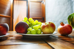 Still life of grape, peach, nectarine and pomegranate. Extremely. Shallow depth of field. Focused on some of grape Stock Images