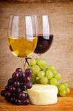 Still life with grapes, cheese and wine Royalty Free Stock Image