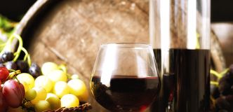 Still life with grapes and a glass of wine stock image