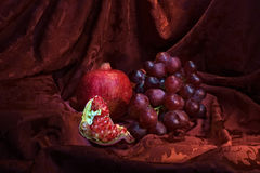 Still life with grapes and pomegranate. royalty free stock images