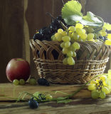 Still life with grapes and red apple Stock Photography