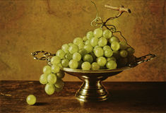 Still life grapes. Still life with grapes on a table Stock Photos