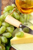 Still-life with grapes white wine. And piece of cheese stock photos