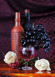Still life with grapes and a wine bottles Stock Image