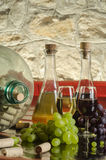 Still life with grapes, wine glasses and wine bottles in old cellar Stock Image