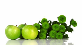 Still life with green apples and green flowers Stock Photography