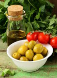 Still life of green  marinated olives,  herbs, tomatoes Stock Photography