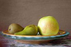 Still life with green pears and apple Royalty Free Stock Photo