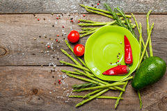 Still life with green plate asparagus, avocado Stock Image