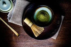 Still life with green tea and Japanese wire whisk made of bamboo Stock Photo