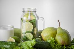 Still life of green vegetables and fruits. royalty free stock images