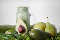 Still life of green vegetables and fruits. Smoothies. royalty free stock photography