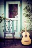 Still Life With Guitar And Chair Stock Photo