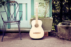 Still Life With Guitar And Chair Royalty Free Stock Photography