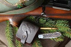 Still life with gun, cartridge and knife Royalty Free Stock Image