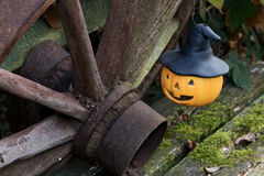 Still life Halloween. With a pumpkin and an old wheel Royalty Free Stock Photo