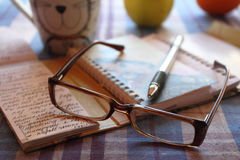Still life: the handle with a notebook and points. The handle and points with a notebook on a table stock images