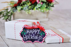 Still life with Happy Holidays sign and boxes Royalty Free Stock Images