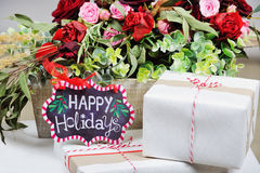 Still life with Happy Holidays sign and present boxes Stock Photo