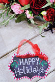 Still life with Happy Holidays sign Stock Photo