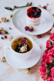 Still life with herbal tea, cake and roses Royalty Free Stock Photo