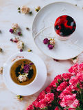 Still life with herbal tea, cake and roses Royalty Free Stock Photography