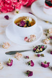 Still life with herbal tea, cake and roses Stock Photography
