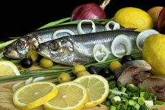 Still life with herring and lemon royalty free stock image