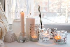Still life home atmosphere in the interior with candles and aroma stick on the windowsill, home decor elements, the concept of. Comfort and coziness stock images