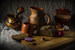 Still life, homemade bread and pottery Stock Images